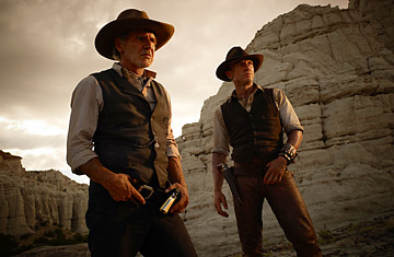 Harrison Ford as the iron-fisted Colonel Dolarhyde and Daniel Craig as a stranger with no memory of his past in Cowboys & Aliens.