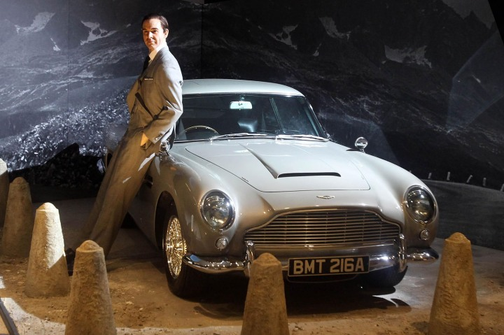 A waxwork of Sean Connery posing with an Aston Martin DB5 from 'Goldfinger' (1964)