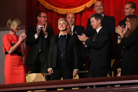 DeGeneres reacts as her family and friends, including de Rossi, applaud her entrance at the Mark Twain Prize ceremony in Washington