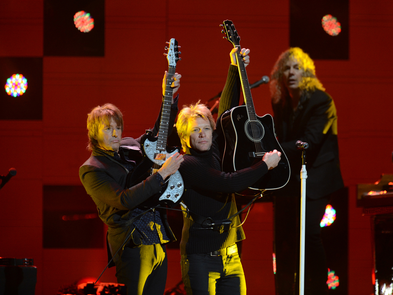 "Jon Bon Jovi (R) performs during ""12-12-12"" a concert benefiting the victims of Hurricane Sandy"
