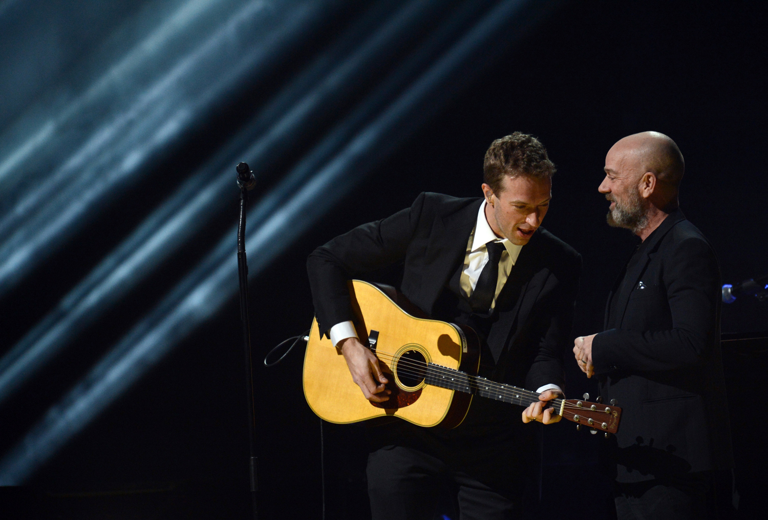 Chris Martin (L) performs with Michael Stipe