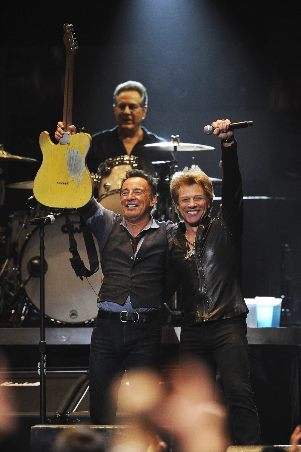 "Bruce Springsteen and Jon Bon Jovi perform during ""12-12-12"" a concert"