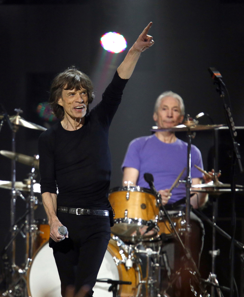 "Mick Jagger of the Rolling Stones performs during the ""12-12-12"" benefit concert for victims of Superstorm Sandy at Madison Square Garden in New York Dec. 12, 2012."