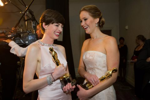 Jennifer Lawrence, winner of the Oscar for Performance by an actress in a Leading Role for 'Silver Linings Playbook' and Anne Hathaway after winning the category performance by an actress in a supporting role for her part in 'Les Miserables' laughing as they hold their Oscars backstage at the 85th Academy Awards at the Dolby Theatre in Hollywood, Calif., on Feb. 24, 2013.