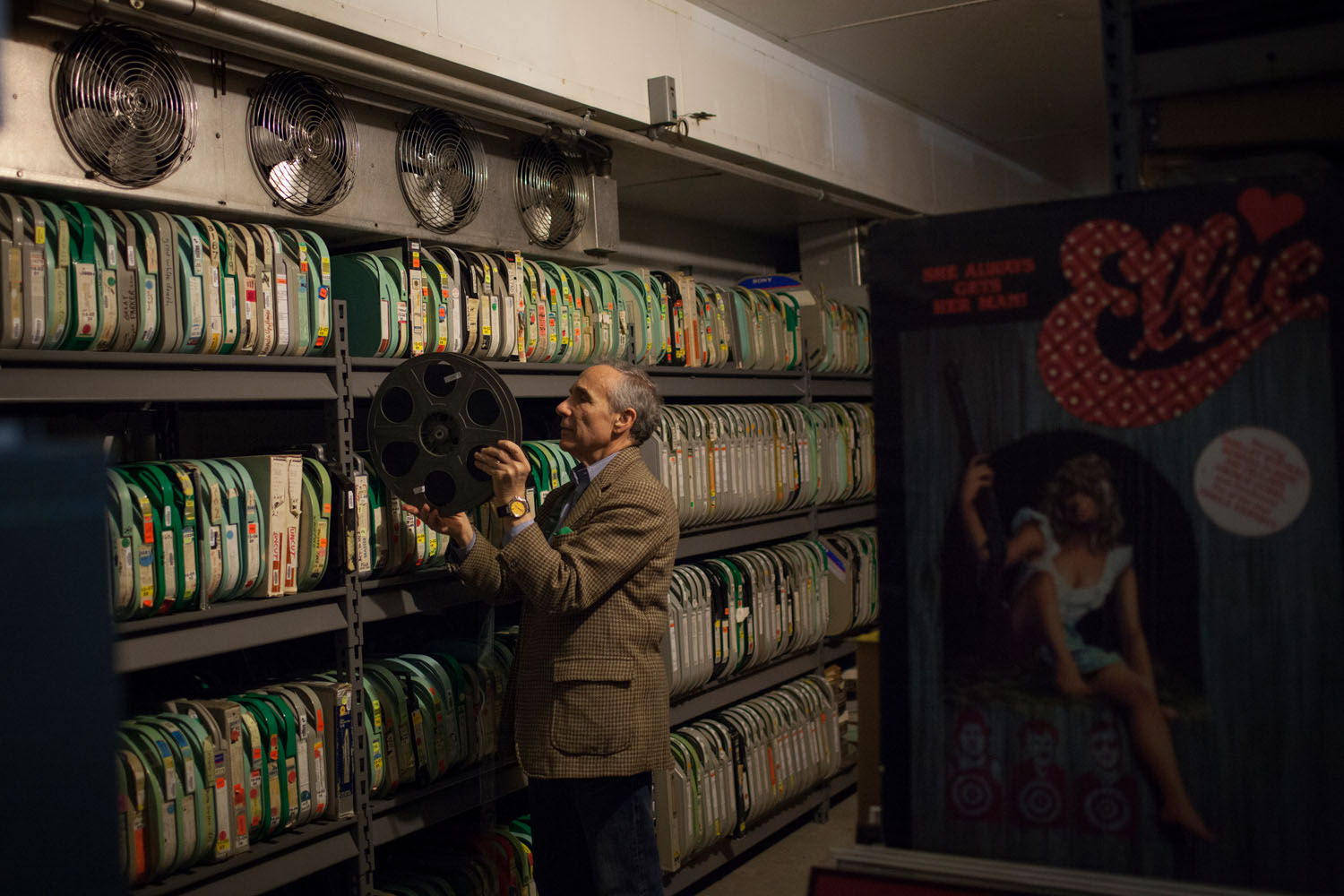 Kaufman files a reel from the 35mm print of the 1987 film 'Troma's Wa' in the archives at Troma's offices.