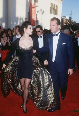 Demi Moore And Bruce Willis walk the red carpet at the Academy Award