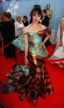Mia Maestro arrives at the 71st Academy Awards