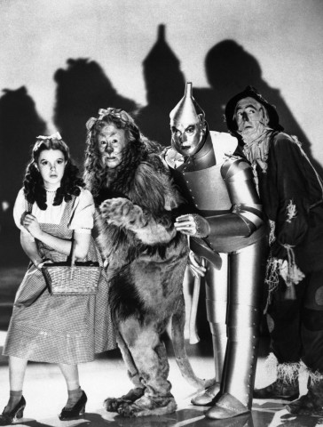 """The cast of the 1939 MGM production of """"The Wizard of Oz"""" stand together during a scene from the movie. Judy Garland as Dorothy, Bert Lahr as the Cowardly Lion, Jack Haley as the Tinman and Ray Bolger as the Scarecrow."""