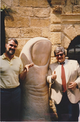 Roger Ebert and Richard Corliss at the Colombe d'Or restaurant in St-Paul-de-Vence, France in the late 1980's. The thumb sculptor is by César Baldaccini.