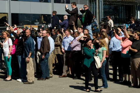 Onlookers and media outside the US.Federal Courthouse as it is evacuated because of a bomb threat April 17, 2013 in Boston.