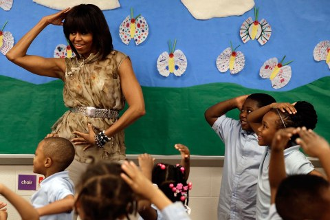U.S. first lady Michelle Obama dances with pre-kindergarten students at the Savoy School in Washington, D.C., on May 24, 2013.