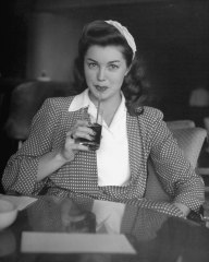 Esther Williams drinking a soda.