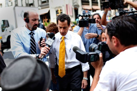 Democratic candidate for New York City Mayor Anthony Weiner is followed by media as he leaves his New York City apartment, July 24, 2013.