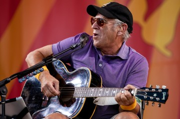 Jimmy Buffett performs at the Fair Grounds Race Course in New Orleans, on May 3, 2012.