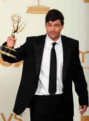 Actor Kyle Chandler holds the award for
