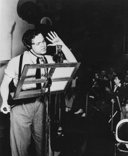 """Orson Welles broadcasts his radio show of H.G. Wells' science fiction novel """"The War of the Worlds"""" in a New York studio at 8 p.m., Sunday, Oct. 30, 1938."""