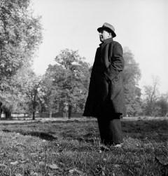 Scholar C.S. Lewis standing in open field; nr. Magdalen College, Oxford University, 1946