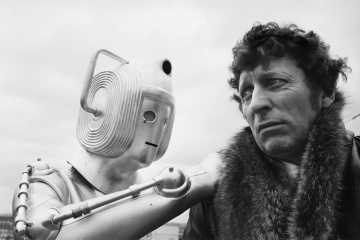 English actor and star of the long running television series, Dr Who, Tom Baker, with one of his arch enemies, the Cybermen.