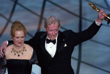 Actor Peter O'Toole holds up the honorary Oscar he was honored with by the Academy of Motion Picture Arts and Sciences as he embraces Meryl Streep, who presented it to him, during the 75th annual Academy Awards March 23, 2003, in Los Angeles.