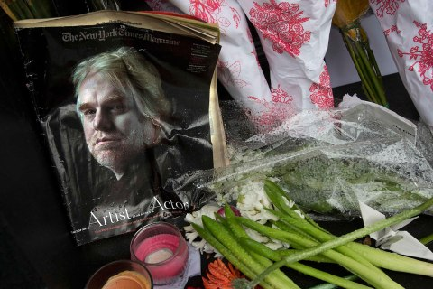 A copy of a New York Times Magazine with a photo of movie actor Philip Seymour Hoffman on the cover is pictured as part of a makeshift memorial in front of his apartment building in New York