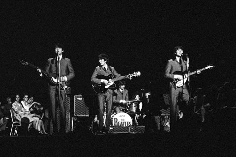 The Beatles 1964 US Tour. British pop group The Beatles on stage in concert at Carnegie Hall in New York during the band+s tour of America.