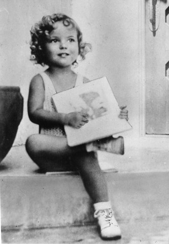 3-year-old child movie star Shirley Temple at her home in California, c. 1931.