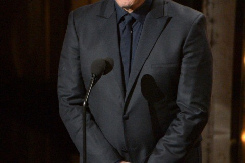 Presenter John Travolta speaks during the Oscars at the Dolby Theatre on Sunday, March 2, 2014, in Los Angeles.